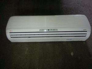 Consola split con su base lg 12000 btu aire acondicionado..