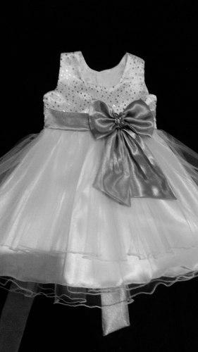 Vestidos de bautizo, primera comunión, pajecitas y bodas.
