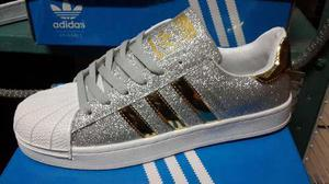 Zapatos adidas super star y nike brillantes 2018