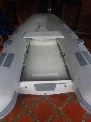 Bote inflable caribe modelo c-9x con motor yamaha 15 hp