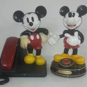 Coleccionables mickey mouse, teléfono, despertador y lata