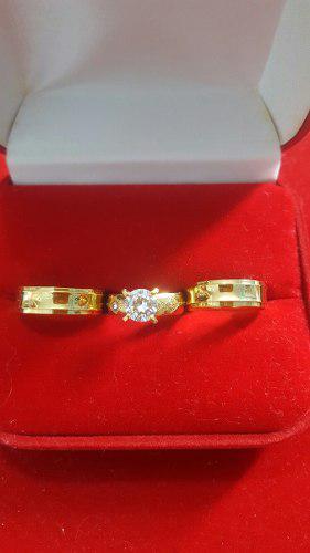 Aros de bodas y anillo de compromiso en acero inoxidable