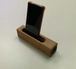 Base de celular (stand) con amplificador de sonido