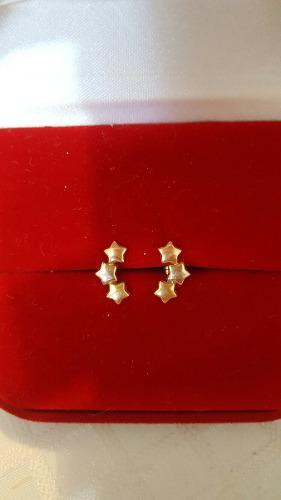 Zarcillos de estrellas en cartier oro 18 k