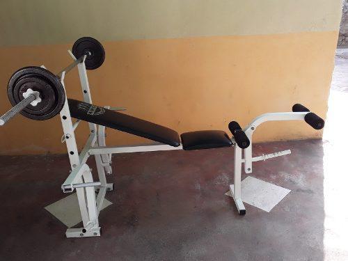 Banco de pesas / barra con discos ejercicios multiples