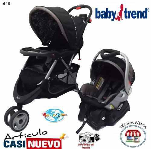 Coche babytrend 3 ruedas con base para vehículo impecable.-