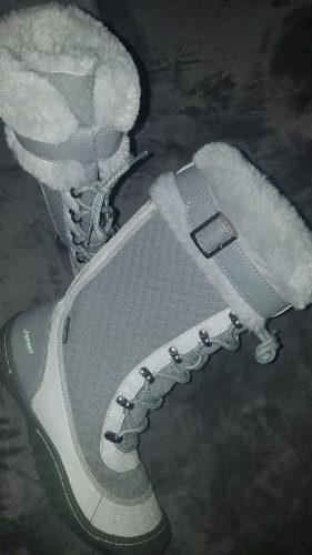 Botas de invierno y chaleco reversible. se vende todo junto.
