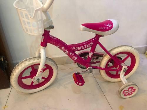 Bicicleta con rueditas laterales