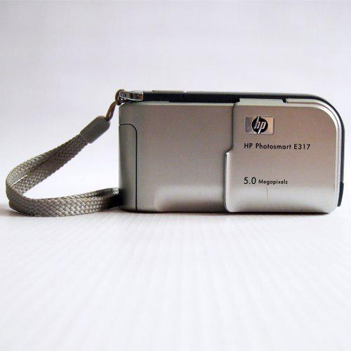 Cámara digital hp photosmart e317 5mpx con memoria sd
