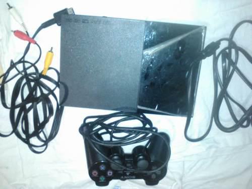 Playstation 2 con un control original sony