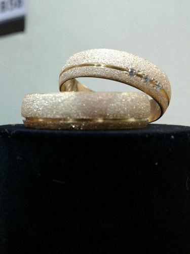 Excelente aros de matrimonio en plata con baño de oro