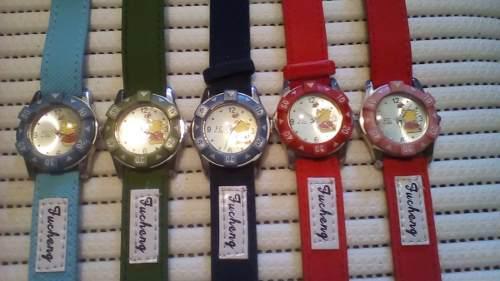 Relojes winnie pooh, para niñas y niños. precio x 2