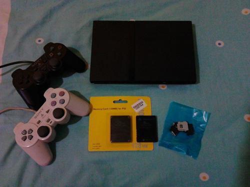 Playstation 2 con accesorios nuevos y usados
