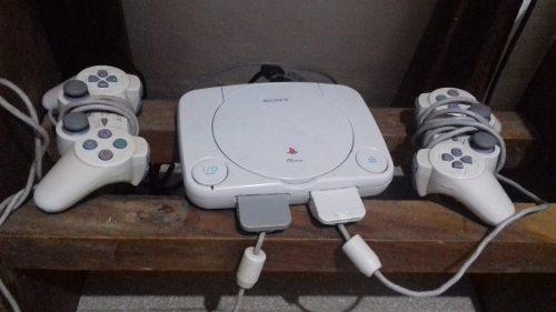 Playstation 1 + 2 memory card+ 2 controles + 8 juegos