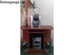 Equipo de sonido lg con su mesa