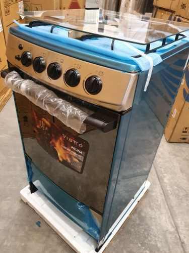 Cocina 4 hornillas marca viotto cromada con horno rostizador
