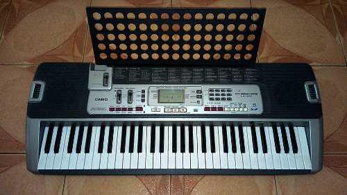 Piano eléctrico casio lk-210