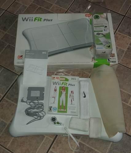 Combo wii fit-wii balance board+essential pak en sus cajas