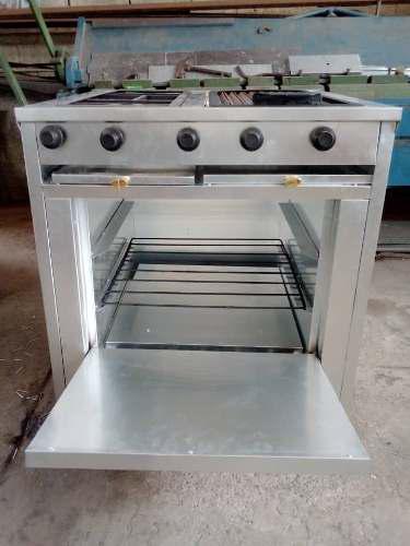Cocina industrial con 2 hornillas, grill y horno.