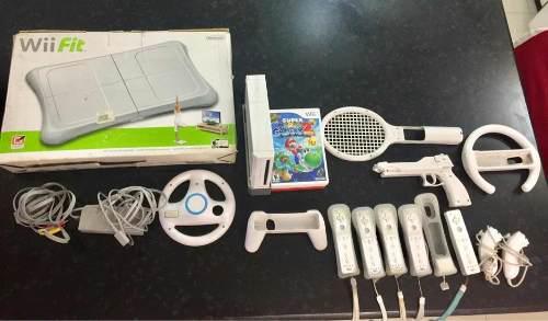 Nintendo wii + juegos + controles + juego de guitar hero