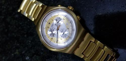 Reloj swatch dorado impecable
