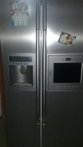 Nevera lg dos puerta verticales solo un año de uso con tv