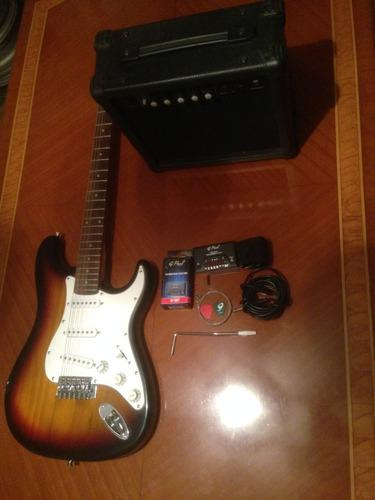 Guitarra eléctrica marca g. paul con amplificador