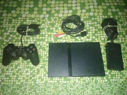 Playstation 2 original + control + memory card + 8 juegos